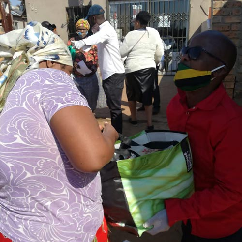 Siyakholwa Support Care Centre_COVID-19 – pandemic food distribution image 8